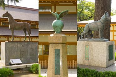 Статуи собаки, лошади и голубя